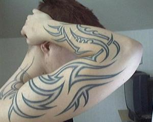 simple tribal arm tattoos