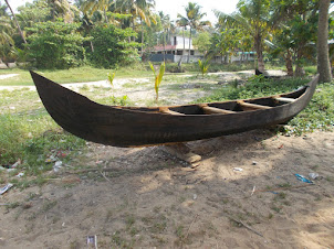 Newly built fishing canoe boat on Marari Beach.