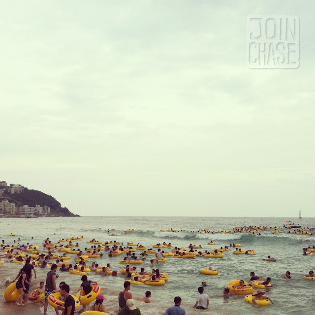 Hundreds of people on inner tubes at Haeundae Beach in Busan, South Korea.