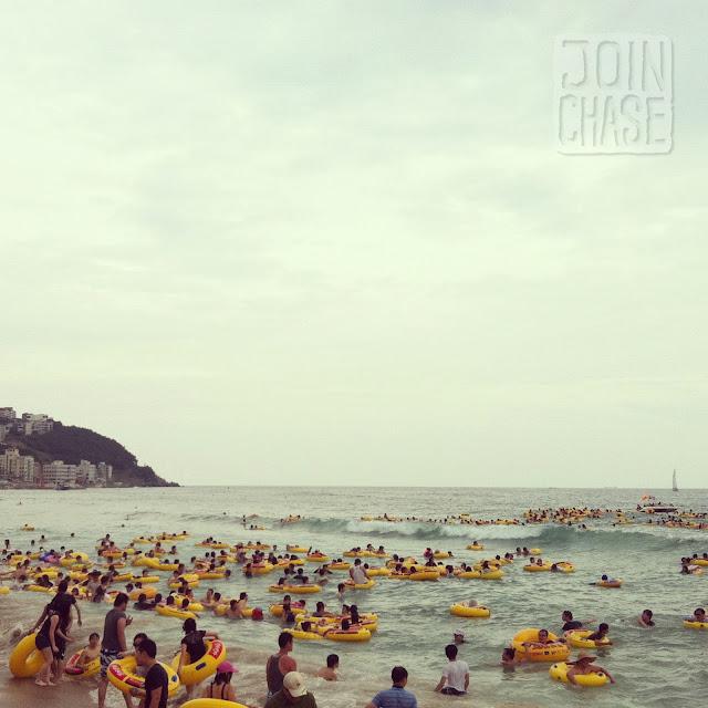 Hundreds of people on inner tubes at Haeundae Beach in Busan, South Korea.