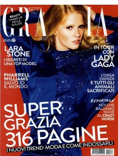 Lara Stone covers Grazia Italia October 2014 in a shimmery blue dress