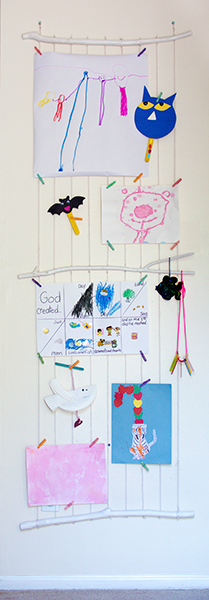Colorful young child's artwork hanging on wall display