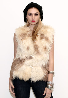 Vintage 1970's vanilla colored marbled Mongolian fur gillet vest with toggle closures.