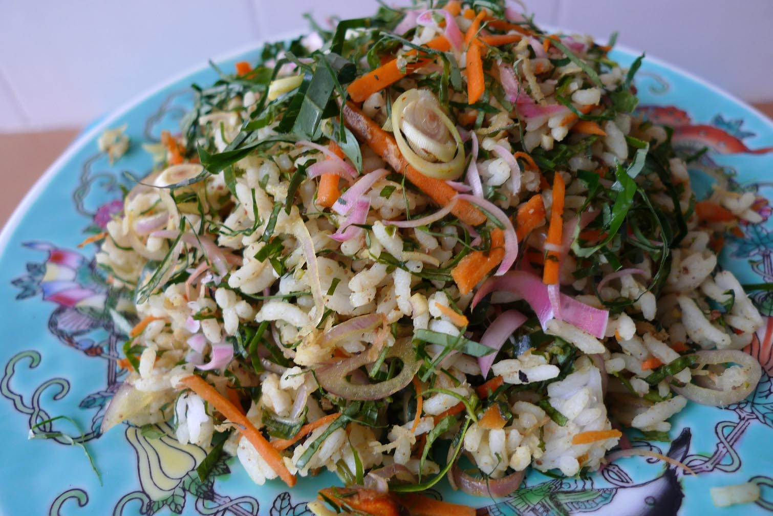 the uses of ulam Nasi ulam (herb rice salad) with aromatic herbs, richness of the toasted coconuts and pungent spices an incredibly healthy & addictive dish.