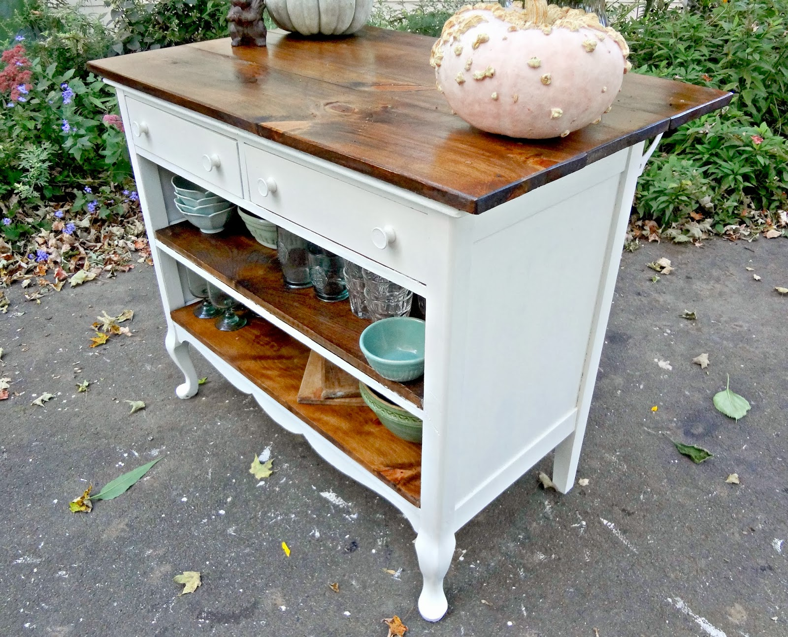 Heir and space antique dresser turned kitchen island for Kitchen island with drawers and seating