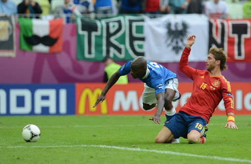 Spain defender Sergio Ramos prevents a goalscoring opportunity from Italy forward Mario Balotelli