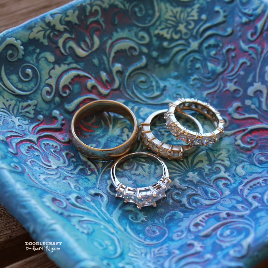 http://www.doodlecraftblog.com/2014/06/damask-polymer-clay-jewelry-dishes.html
