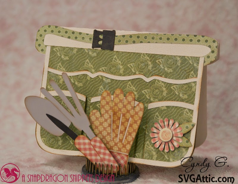 Garden apron card showing removable trowel, rake and glove