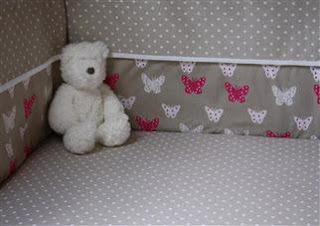 Union Jack and Jill Pink Butterfly Bumper. Shown in close up.