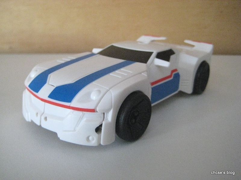 Jazz Transforms Into A White Sports Car With Some Blue And Red Stripes.  This Version Of Jazz Has A More Rounded Vehicle, Particularly The Hood  Being Quite ...