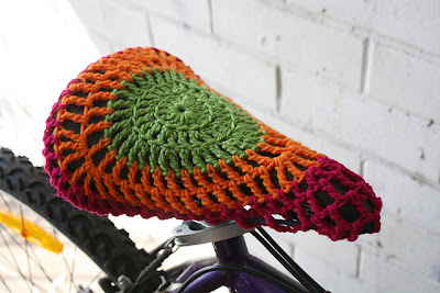 Yarnbombed bicycle seat by Emma Wilkinson