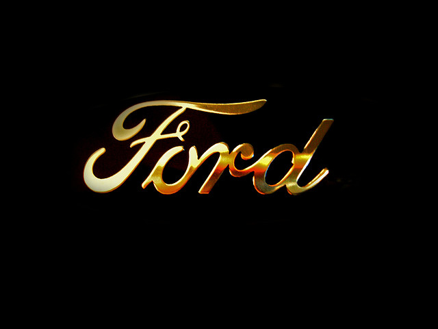 83 ford logo behind the badge is that henry fords for Ford motor company history background
