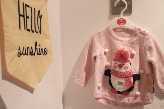 baby musical christmas jumper pink with penguin wearing scarf and hat from matalan