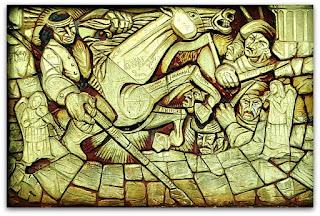 Ilustração em muro do Paseo de La Identidad, em Puerto Iguazú, na Argentina. Guerreiro indígena sobre um cavalo.