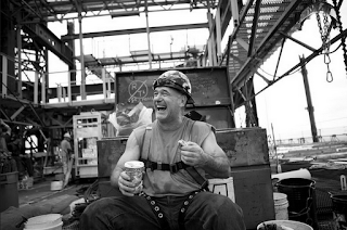 Construction worker taking a break, enjoying his job