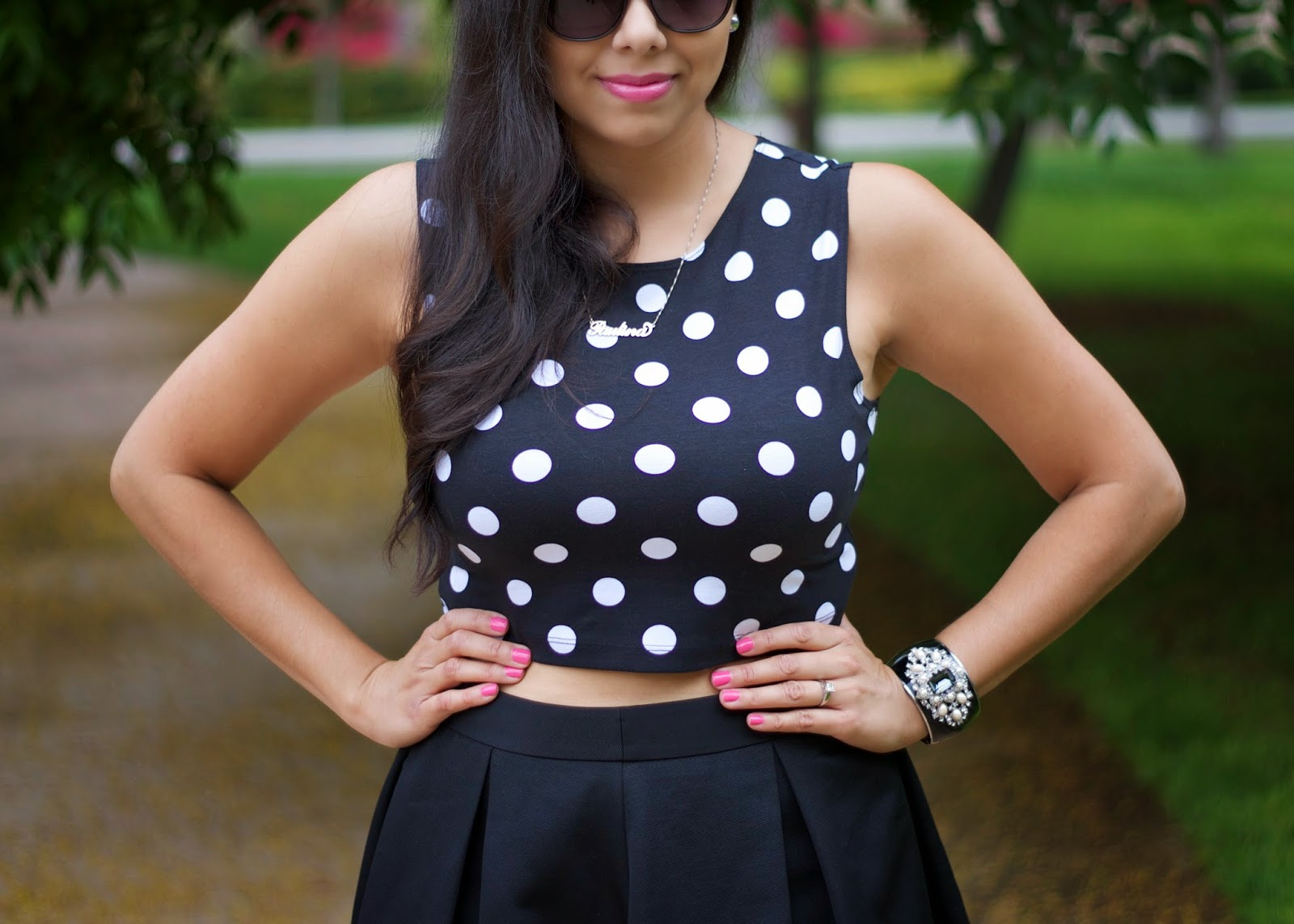 Pink Nails with all black outfit, Ann Taylor elegant cuff, polka dot crop top with accessories, black white dotted outfit details