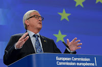 Photo of EU Commission President Jean Claude Junker at podium of European Commission giving his speech on the  Greek  Referendum.  Courtesy of the European Commission