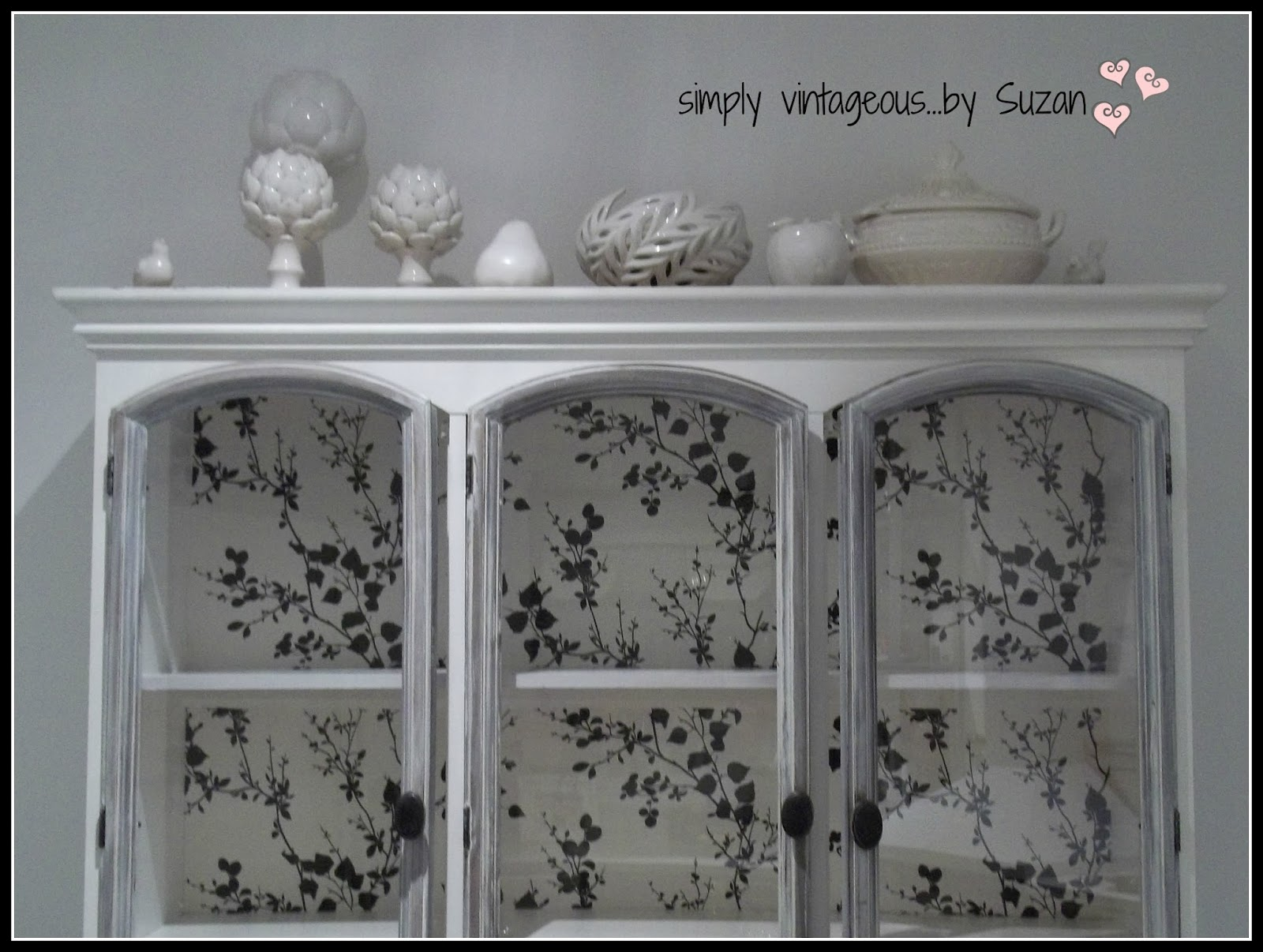 Black, white, wallpapered hutch