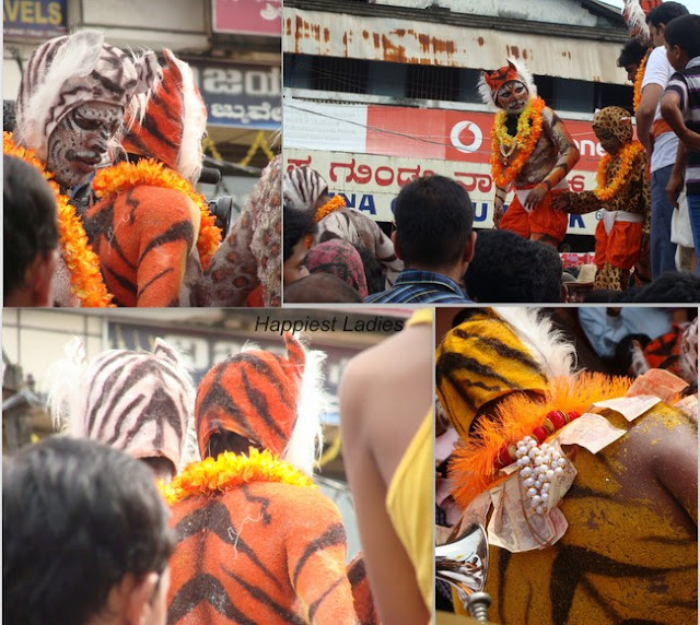 Huli Vesha is men dressed in tiger mask and body paint