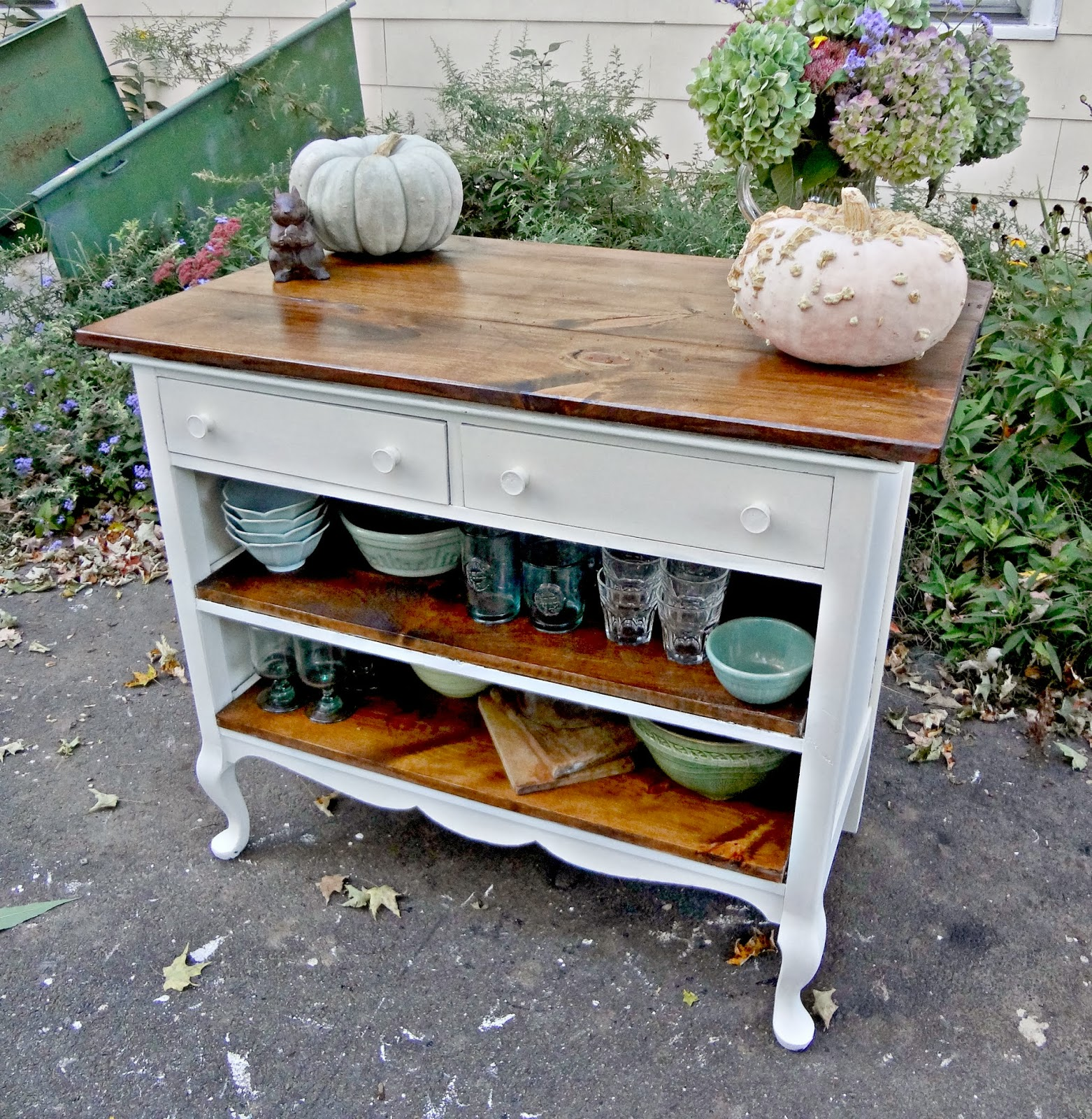 Heir and space antique dresser turned kitchen island for Repurposed antiques ideas