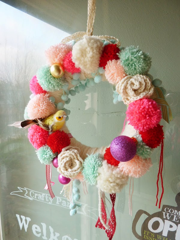 pompom easter wreath with birds and yarn