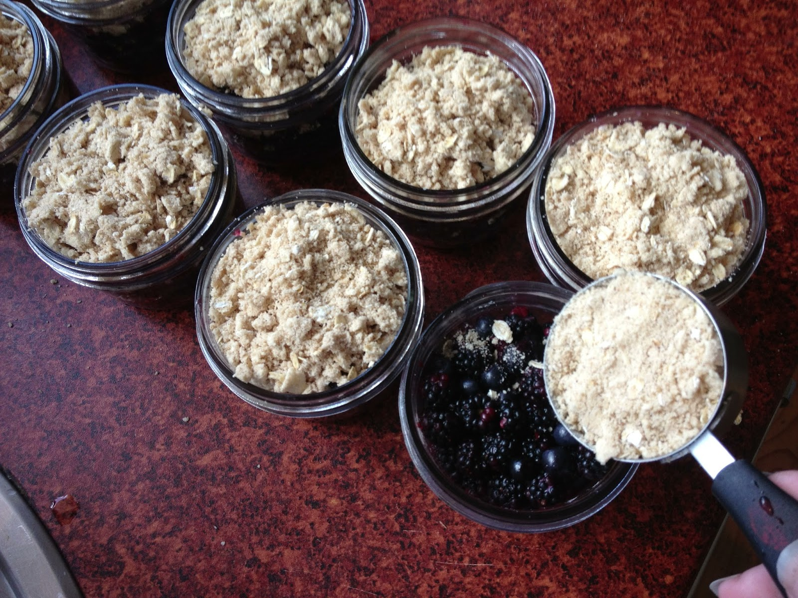 Add crumble topping to each jar. (Or spread over your 9x13 pan evenly ...