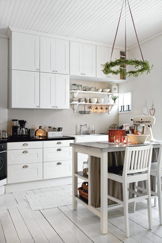 decoration is kept simple in this scandinavian kitchen with a slim wreath hanging over the island - How To Decorate Your Kitchen Island For Christmas