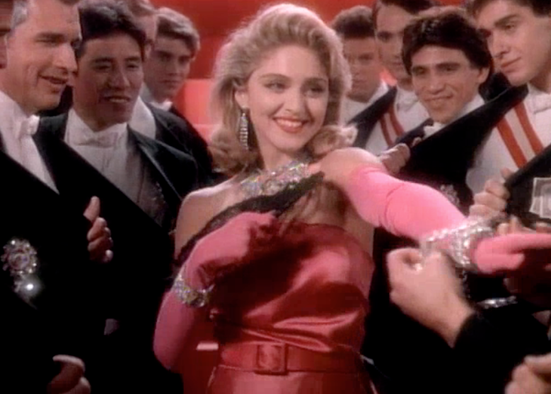 ' ' from the web at 'http://1.bp.blogspot.com/-ShTAuERZRPI/VQYe2rWjG4I/AAAAAAAAEUM/aJLNoQytOtw/s1600/madonna%2bmaterial%2bgirl.png'