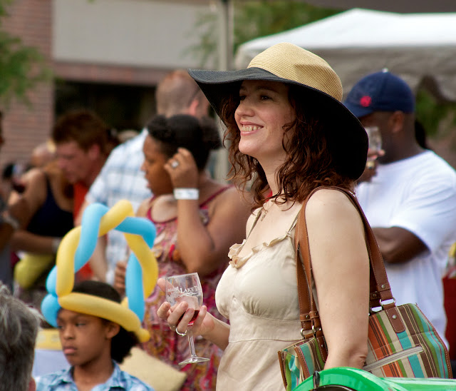 Taste of Downtown in Lansing, Michigan. Guests enjoy live music, food & wine tastings.