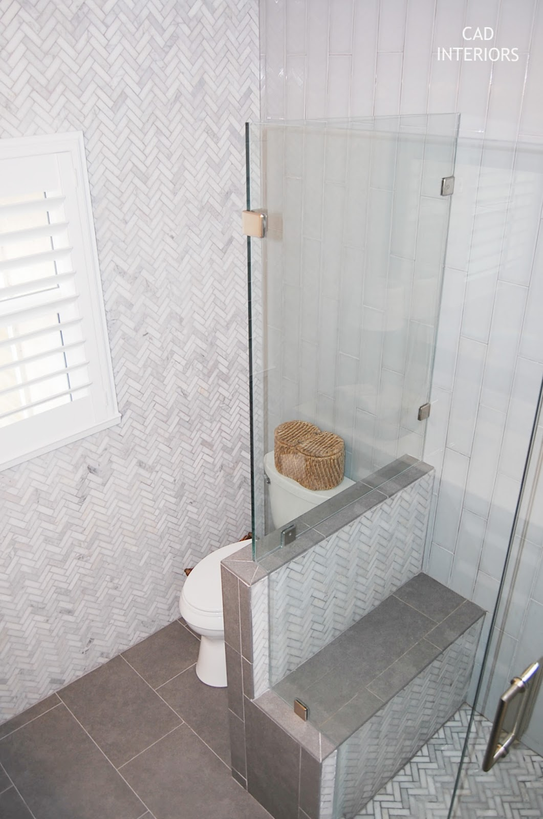 hidden camode pony wall bench new shower herringbone tile subway tile CAD INTERIORS main bathroom renovation