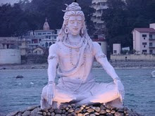 "Famous ""blue"" statue of Lord Shiva meditating on the riverbank"