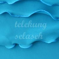 Telekung lycra biru corak curly di tepi