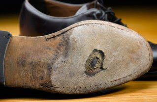 someone else's holey shoe; source http://blog.leffot.com/2009/09/23/the-dr-will-see-you-now/