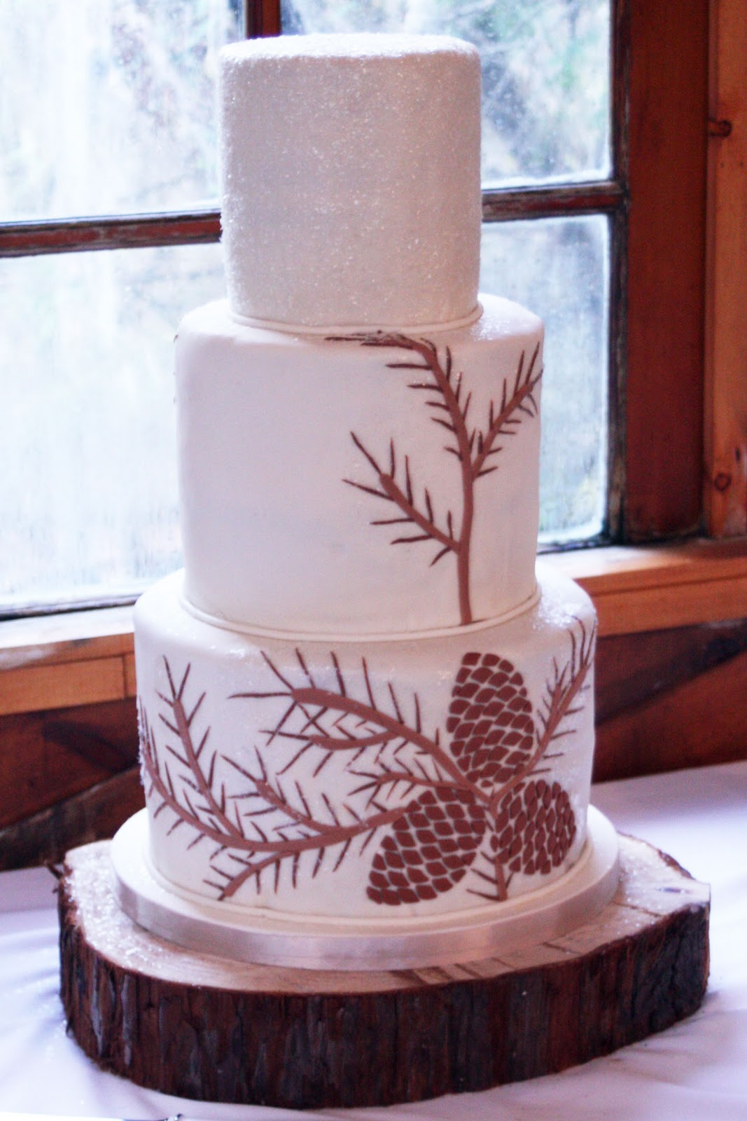 The pine cone wedding cake followed the theme of the wedding.