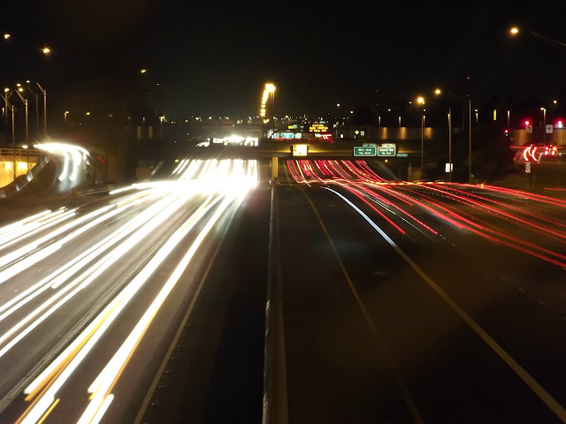 speeding traffic, car lights, street at night