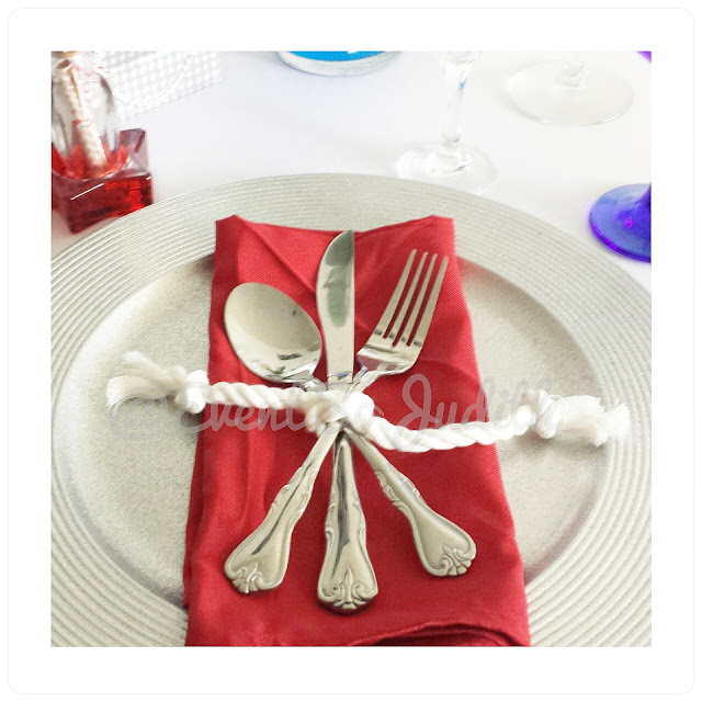 nautical theme table setting using red and white