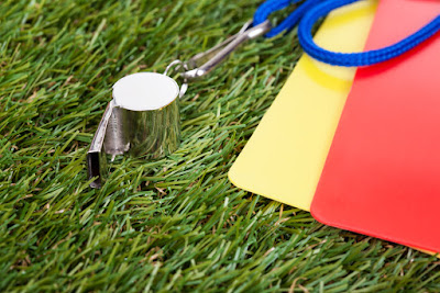 a coach's whistle is pictured on the turf