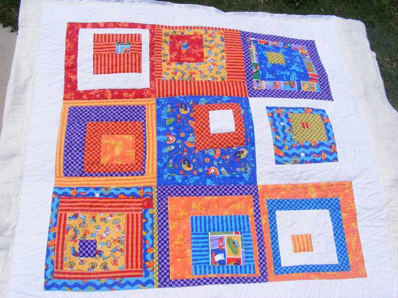 Tia curtis quilts julie 39 s space quilt for Spaceship quilt