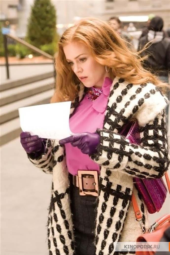 an image from the movie confessions of a shopaholic, isla fisher holding a bill, fashion