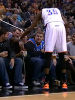 Kevin Durant checks on female courtside fan