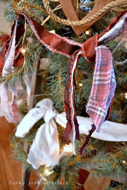 Ripped fabric and flannel shirts for garland / The making of a stepladder Christmas tree, via : http://www.funkyjunkinteriors.net/