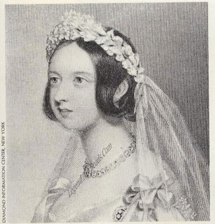 Queen Victoria on her wedding day in 1840. She is wearing a necklace of large round diamonds.