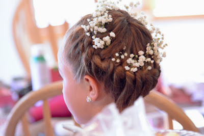 braided flower girl hair with babies breath