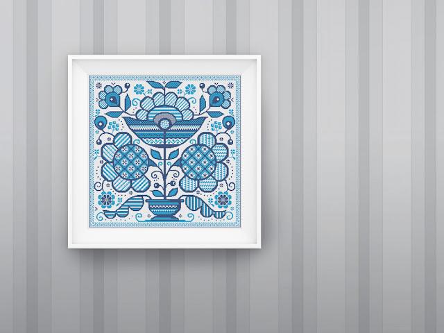 вышивка крестиком в народном стиле в рамке на стене