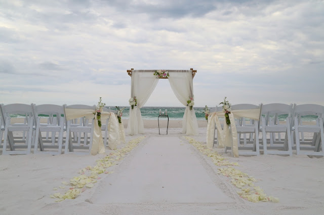 beach wedding decoration ideas, fresh flower bamboo arbor and aisle way