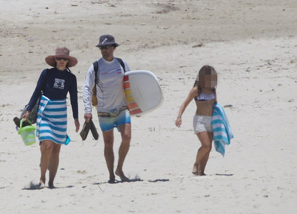 Crown Princess Mary was pictured in the surf with her husband Crown Prince Frederik and their children Prince Christian, Princess Isabella and Princess Josephine.