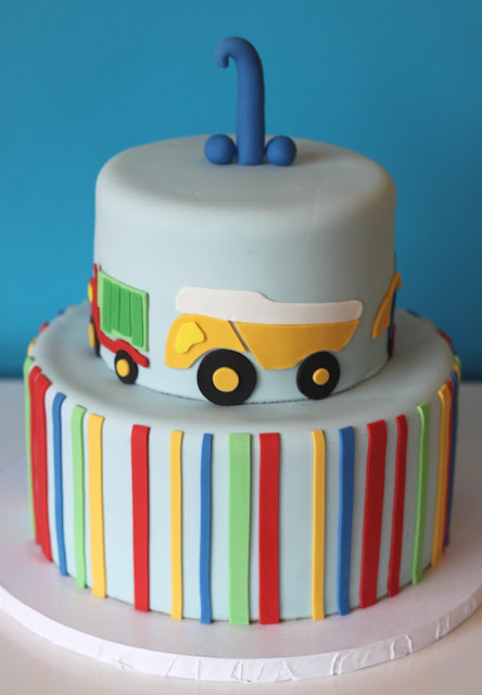 Colorful First Birthday Cake wth Trucks MN