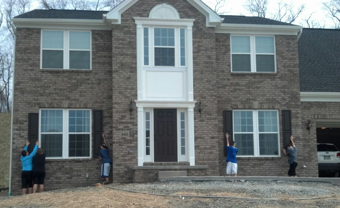 Savoy ryan home shutters vs no shutters garage for Brick houses without shutters
