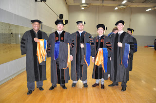 Ph.D. graduates include (l to r) Dr. David Rempert, Shawn Ryals-Keller, Matthew Matusiak, Yingyos Leechaianan, and Pierre Rivolta.