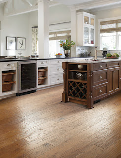 Cork wood flooring in kitchen with white and brown cabinets